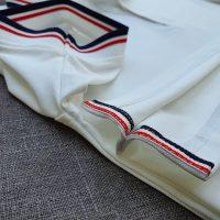 Áo polo phối sọc trắng - aodongluc