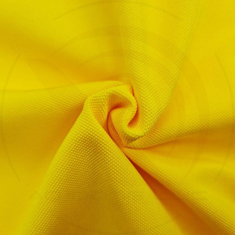 Chất vải áo thun cổ trụ polo bo trơn cá sấu lạnh poly thấm hút màu vàng nghệ