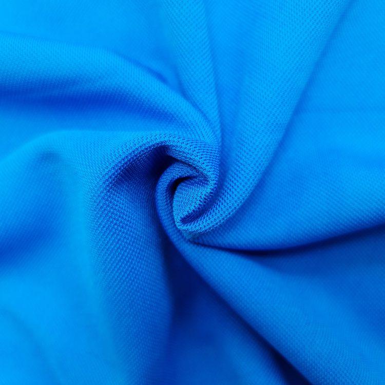 Hình chụp cận cảnh chất vải áo polo bo trơn cá sấu mè unisex xanh ya