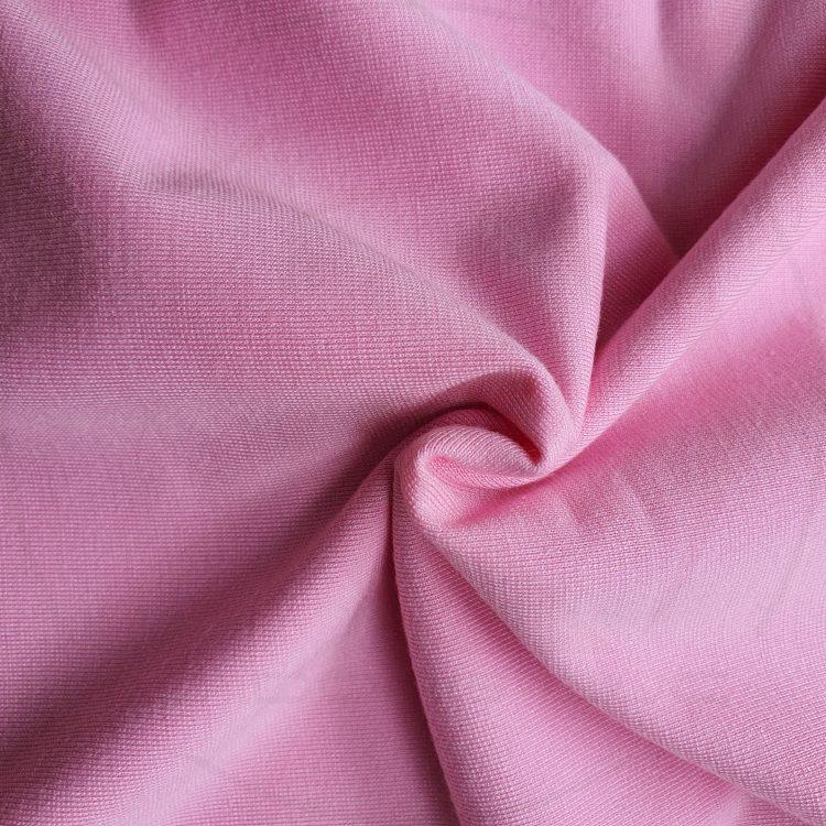 Hình chụp cận cảnh chất vải áo thun cổ tròn ngắn tay supe unisex unisex hồng phấn