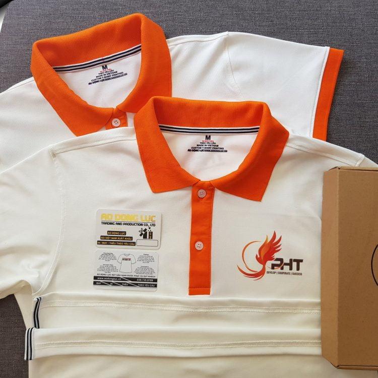 Đồng phục áo thun polo trắng phối cam in chuyển nhiệt