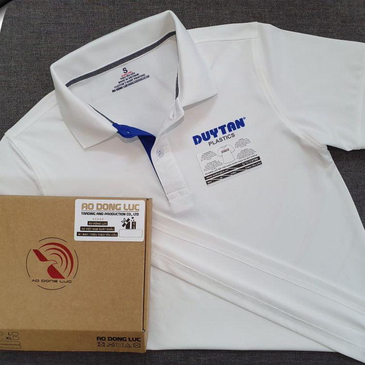 Đồng phục áo thun polo màu trắng phối trụ trong xanh bích in chuyển nhiệt logo